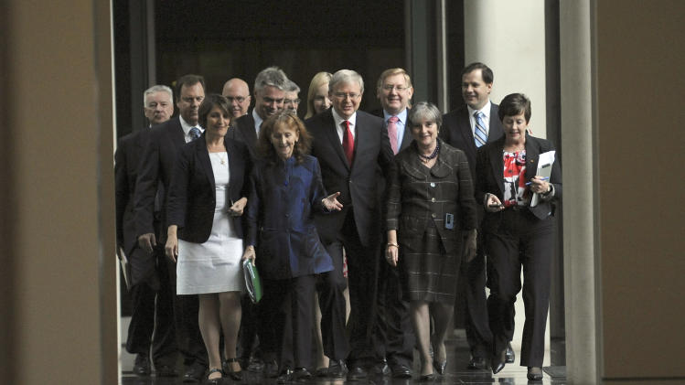 Kevin Rudd, center, arrives with supporters for a caucus meeting in Canberra, Australia, Monday, Feb. 27, 2012. Australian Prime Minister Julia Gillard on Monday won a resounding victory in a leadership ballot against Rudd, the party leader she deposed two years ago, and stamped her authority on her government, media reported.   (AP Photo/Alan Porritt, Pool)