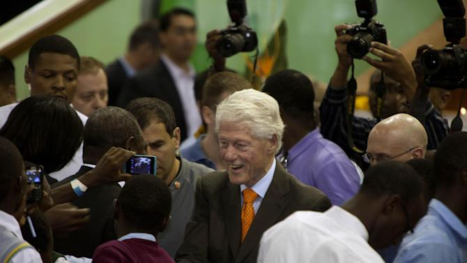 Former U.S. President Bill Clinton, center, greets participants at the Kasarani Sports Complex in Nairobi, Kenya, Saturday, May 2, 2015. Clinton and his daughter Chelsea are on a nine-day tour of Clinton Foundation projects in Africa. (AP Photo/Sayyid Azim)