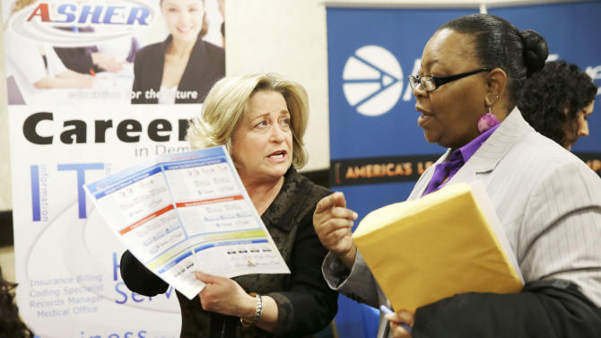 In this Wednesday, Jan. 22, 2014, photo, recruiter Valera Kulow, left, speaks with job seeker Monic Spencer during a career fair in Dallas. The Labor Department releases weekly jobless claims on Thursday, March 5, 2014. (AP Photo/LM Otero, File)
