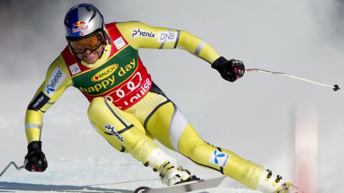 Aksel Lund Svindal, of Norway, speeds down the hill during the men's World Cup super-G ski race event in Lake Louise, Alberta, Sunday Nov. 25, 2012. (AP Photo/The Canadian Press, Jonathan Hayward)