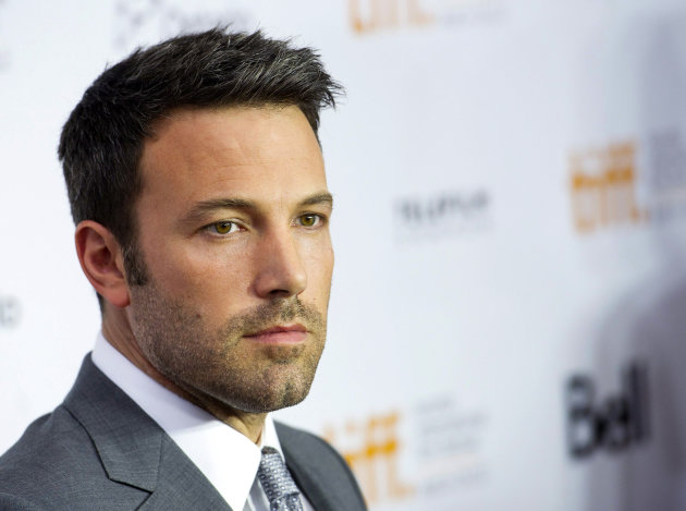 FILE - This Sept. 7, 2012 file photo shows actor and director Ben Affleck poseing for a photograph on the red carpet at the gala for the new movie &quot;Argo&quot; during the 37th annual Toronto International Film Festival in Toronto. Affleck is comparing US Republican presidential candidate Mitt Romney to past presidential hopefuls Al Gore, Michael Dukakis and Bob Dole. But the actor and director, who has been outspoken in support of Democratic causes in the past, also doesn&#39;t offer full-throated support for President Barack Obama. (AP Photo/The Canadian Press, Nathan Denette)