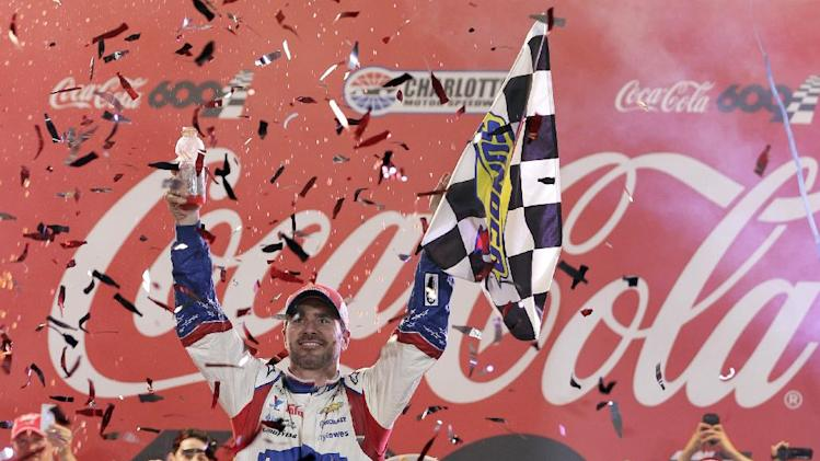 Jimmie Johnson celebrates in Victory Lane after winning the NASCAR Sprint Cup series Coca-Cola 600 auto race at Charlotte Motor Speedway in Concord, N.C., Sunday, May 25, 2014