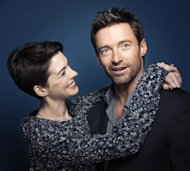 This Dec. 2, 2012 photo shows actors Anne Hathaway, left, and Hugh Jackman in New York. Hathaway portrays Fantine and Jackman portrays Jean Valjean in the film adaptation of the Victor Hugo novel, &quot;Les Miserables.&quot; The film opens on Christmas Day. (Photo by Victoria Will/Invision/AP)