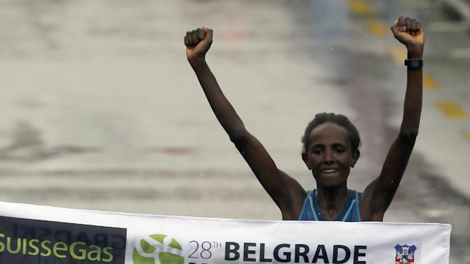 Abebu Gelan of Ethiopia crosses the finish line to win the women's event at the 28th international Belgrade Marathon race, in Belgrade, Serbia, Saturday, April 18, 2015. Gelan finished in 2 hours, 33 minutes and 12 seconds. (AP Photo/Darko Vojinovic)