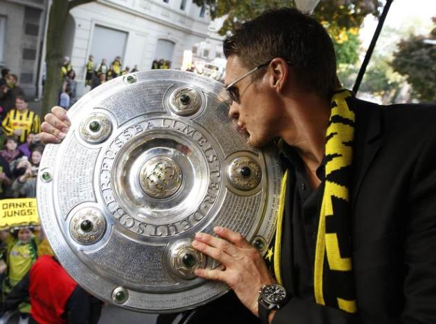 Dortmund's Midfielder Sebastian Kehl  Kisses AFP/Getty Images