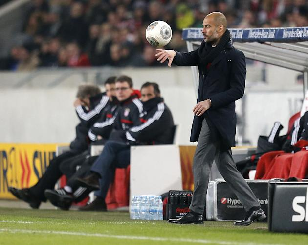Bayern head coach Pep Guardiola of Spain carries a ball during a German first soccer division Bundesliga match between VfB Stuttgart and FC Bayern Munich in Stuttgart, Germany, Wednesday, Jan. 29, 201