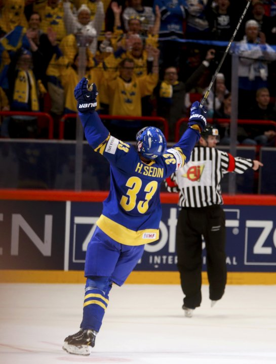 Sweden's Sedin celebrates after scoring a goal against Finland during their 2013 IIHF Ice Hockey World Championship semi-final match at the Globe Arena in Stockholm
