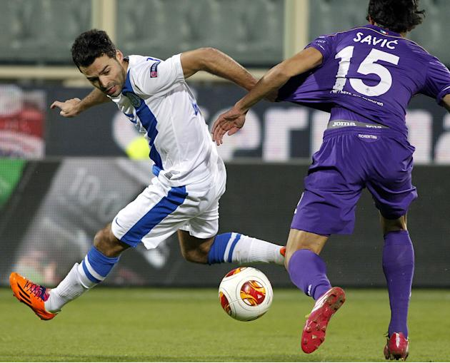 Fiorentina's Stefan Savic, right, challenges for the ball with Dnipro's Bruno Gama during their Europa League Group E soccer match at the Artemio Franchi stadium in Florence, Italy, Thursday,