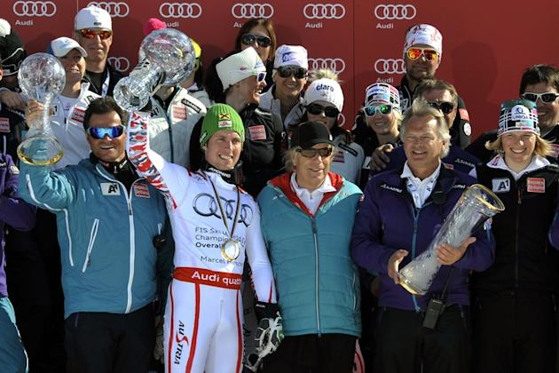 Overall World Cup Winner Austria's Marcel Hirscher (2nd L) Pose With The Austrian Team AFP/Getty Images