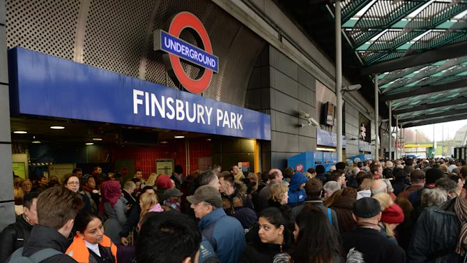 Travelers are locked out of Finsbury Park station, London, where they were directed to go as trains in and out of King's Cross have been cancelled because of overrunning Network Rail engineering works north of the station, with a reduced service tomorrow, Saturday, Dec. 27, 2014. (AP Photo/PA, Stefan Rousseau) UNITED KINGDOM OUT NO SALES  NO ARCHIVE
