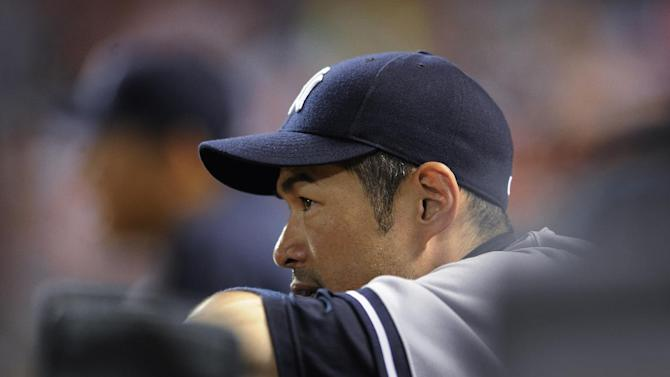 In this July 13, 2014, file photo, New York Yankees' Ichiro Suzuki watches from the dugout during a baseball game against the Baltimore Orioles in Baltimore. Suzuki has passed his physical and finalized a $2 million, one-year deal with the Miami Marlins. The Marlins made the announcement Tuesday night, Jan. 27, 2015