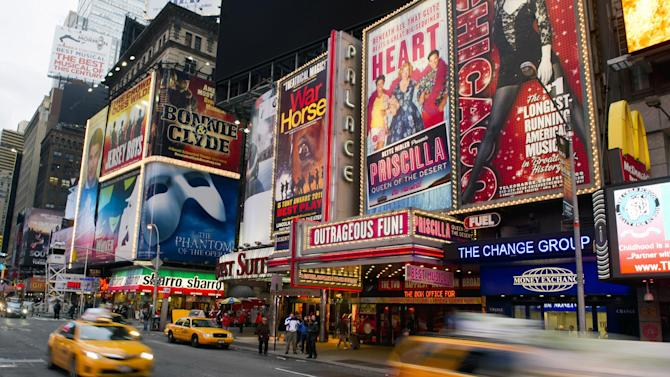 "FILE - This Jan. 19, 2012 file photo shows billboards advertising Broadway shows in Times Square, in New York. The TEDxBroadway conference will be help Monday, Jan. 28, 2013, at the off-Broadway complex New World Stages. The one-day event is bringing together more than a dozen producers, marketers, entrepreneurs, academics, economists and artists. All will try to answer the question: ""What is the best Broadway can be?""  (AP Photo/Charles Sykes, file)"