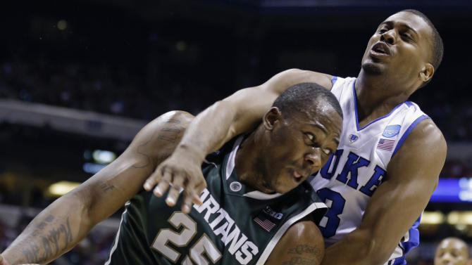 Michigan State forward Derrick Nix (25) and Duke guard Tyler Thornton (3) fight for a rebound during the first half of a regional semifinal in the NCAA college basketball tournament, Friday, March 29, 2013, in Indianapolis. (AP Photo/Michael Conroy)