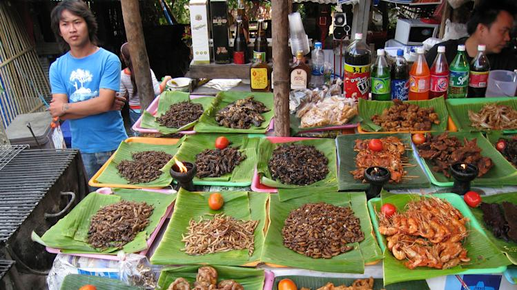 This Feb. 20, 2008 photo provided by the United Nations Food and Agriculture Organization (FAO) shows insects for sale at a market in Chiang Mai, Thailand. The U.N. has new weapons to fight hunger, boost nutrition and reduce pollution, and they might be crawling or flying near you right now: edible insects. The Food and Agriculture Organization on Monday, May 13, 2013, hailed the likes of grasshoppers, ants and other members of the insect world as an underutilized food for people, livestock and pets. A 200-page report, released at a news conference at the U.N. agency's Rome headquarters, says 2 billion people worldwide already supplement their diets with insects, which are high in protein and minerals, and have environmental benefits.  (AP Photo/Arnold Van Huis, FAO, ho)
