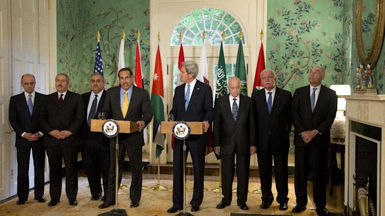 The Arab League leaders led by Qatar's Prime Minister and Foreign Minister Hamad bin Jassim bin Jabr Al-Thani, from fourth from left, with Secretary of State John Kerry and Arab League Secretary-General Nabil Elaraby, speaks to the media following their meeting at Blair House in Washington, Monday, April 29, 2013.   (AP Photo/Manuel Balce Ceneta)