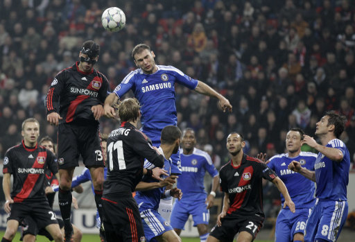 Chelsea's Frank Lampard and Leverkusen's Michael Ballack, second from left, challenge for the ball during the Champions League Group E soccer match between Bayer 04 Leverkusen and Chelsea FC Wednesday, Nov. 23, 2011 in Leverkusen, Germany. (AP Photo/Frank Augstein)