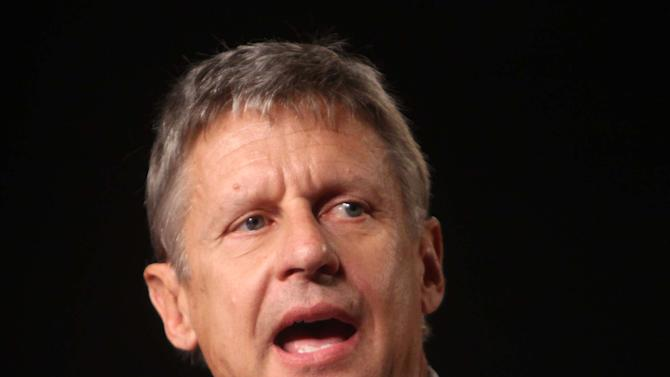 FILE - In this Sept 23, 2011 file photo, Libertarian Party presidential candidate, former New Mexico Gov.  Gary Johnson speaks in Orlando, Fla. President Barack Obama's presidential campaign is paying close attention to two candidates mounting third party campaigns for the presidency, believing they could draw votes from rival Mitt Romney and help the president to victory in a few tightly contested states.  (AP Photo/Joe Burbank, Pool, File)