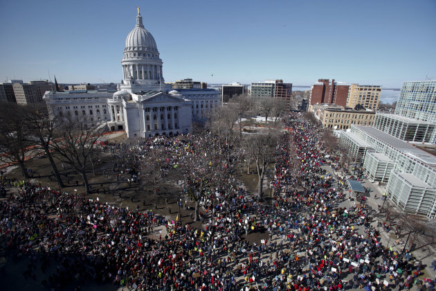 FILE - In this Feb 19, 2011 file photo, protesters gather outside the state Capitol in Madison, Wis. The standoff over union rights that rocked Wisconsin and the nation for weeks. More than a year aft