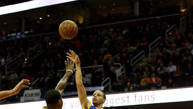 Curry's 29 lead Warriors over Cavs in OT