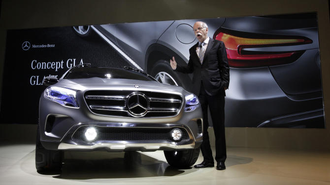"""Dieter Zetsche, chairman of Daimler AG, unveils Mercedes-Benz new concept car """"GLA"""" during a press conference ahead of the Shanghai International Automobile Industry Exhibition (AUTO Shanghai) in Shanghai, China Friday, April 19, 2013. (AP Photo/Eugene Hoshiko)"""