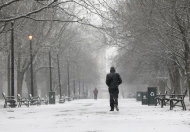 A pedestrian walks through the snow in Washington Park on Friday, Feb. 8, 2013, in Albany, N.Y. Parts of the New York region still cleaning up from Superstorm Sandy are bracing for a winter storm that&#39;s expected to blanket the Northeast with heavy snow Friday and Saturday. (AP Photo/Mike Groll)