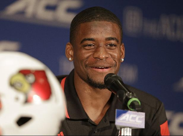 Louisville's Devante Parker answers a question during a news conference at the Atlantic Coast Conference Football kickoff in Greensboro, N.C., in this July 20, 2014 file photo.  Parker broke his foot at practice late last week and is expected to miss at least six weeks. Parker set a school record with 12 TD catches last season and has first-round draft pick talent