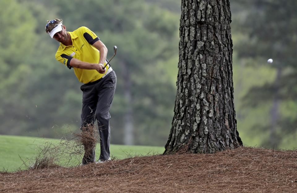 David Lynn, of England, hits out of the rough off the 15th fairway during the first round of the Masters golf tournament Thursday, April 11, 2013, in Augusta, Ga. (AP Photo/David J. Phillip)