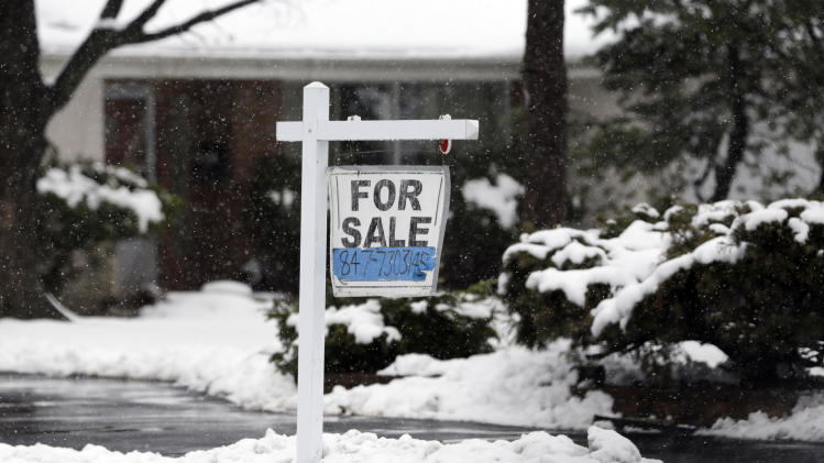 In this Wednesday, Feb. 27, 2013 photo, a for sale sign hangs outside a home in Glenview, Ill. Average U.S. rates on fixed mortgages were little changed the first week of March, hovering near historic lows. The lowest mortgage rates in decades have boosted home sales and helped the market rebound. (AP Photo/Nam Y. Huh)