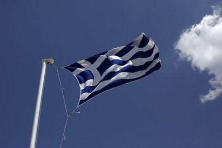 Greek national flag flutters atop Lycabetus hill in Athens