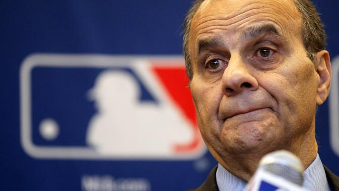 Joe Torre, executive vice president for baseball operations for Major League Baseball, listens to reporters question about instant replay during a news conference after meeting with baseball owners, Thursday, Nov. 15, 2012, in Chicago. (AP Photo/Charles Rex Arbogast)