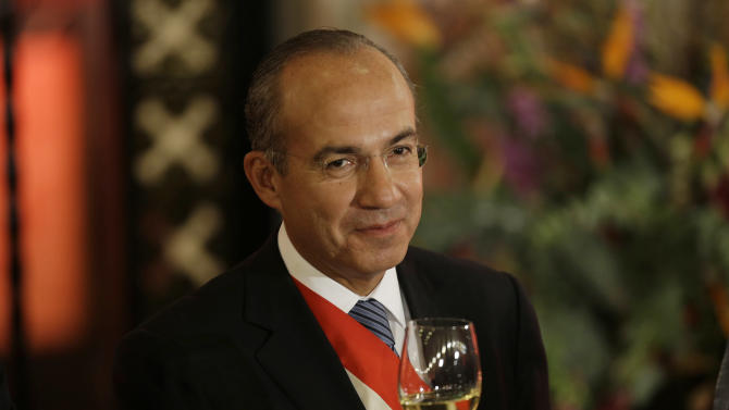 Mexico's President Felipe Calderon raises his glass during his last state dinner in Mexico City, Friday, Nov. 30, 2012. The party that ruled Mexico for seven decades returns to power Saturday with a president from a new generation to govern a country that has changed dramatically in the 12 years since the Institutional Revolutionary Party last held the top post. (AP Photo/Dario Lopez-Mills)