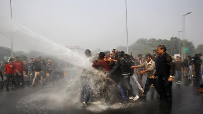 Indian police use water cannon to disperse protesters demonstrating against a gang rape and brutal beating of a 23-year-old student on a bus in New Delhi, India, Sunday, Dec. 23, 2012. The attack last Sunday has sparked days of protests across the country. (AP Photo/Tsering Topgyal)