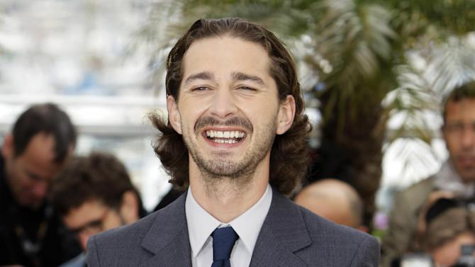 "FILE- In this May 19, 2012, file photo, actor Shia LaBeouf poses during a photo call for Lawless at the 65th international film festival, in Cannes, southern France. LaBeouf is pulling the plug on his Broadway debut. The star of the ""Transformers"" franchise had been slated to appear opposite Alec Baldwin in ""Orphans"" but producers said Wednesday that LaBeouf would not be continuing ""due to creative differences."" (AP Photo/Francois Mori, File)"