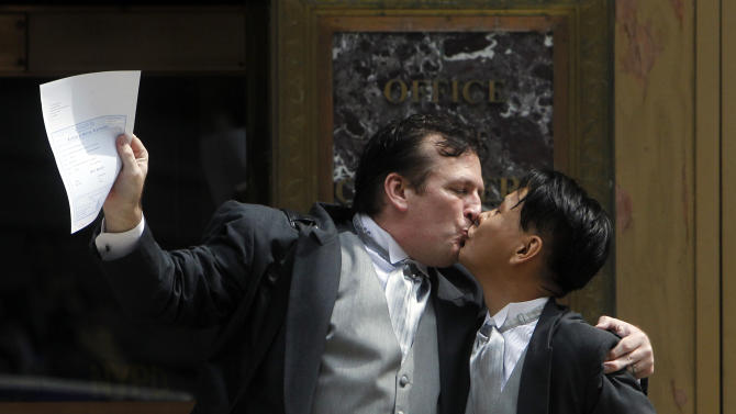 Patrick Plain, left, and Seong Man Hong, both of New York, celebrate after getting married at the City Clerk's office in New York Sunday, July 24, 2011. Hundreds of gay couples were expected to marry in New York and across the Empire State on the first day of same-sex marriage ceremonies. (AP Photo/Jason DeCrow)