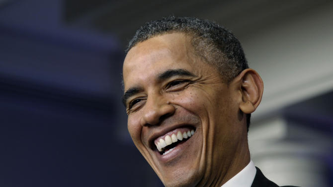 Obama eyes modest momentum on Capitol Hill in 2014