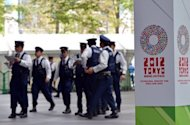 "Police check facilities at the venue of the International Monetary Fund (IMF) and World Bank Group annual meeting in Tokyo on October 9. The IMF slashed its global growth forecast and warned things could get much worse if the eurozone crisis is not quelled and Washington fails to reverse the looming ""fiscal cliff"" austerity plan"