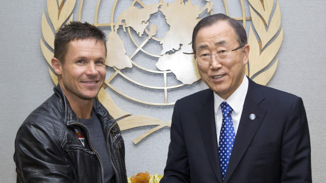 In this photo provided by the United Nations, Austrian skydiver, base jumper and daredevil Felix Baumgartner, left, and United Nations Secretary General Ban Ki-moon pose for photographers at United Nations Headquarters, Tuesday, Oct. 23, 2012. Baumgartner, who set records with his 24 mile free fall, offered to give Ban skydiving lessons during their photo opportunity. (AP Photo/The United Nations, Rick Bajornas)