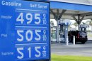 A gas station uses upside-down number 2's as 5's to display prices of gasoline, which has jumped over five dollars a gallon, in Carlsbad, California