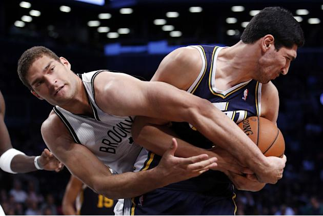 Brooklyn Nets' Brook Lopez, left, fights for possession with Utah Jazz's Enes Kanter, right, during an NBA basketball game Tuesday, Nov. 5, 2013, in New York. Brooklyn won 104-88