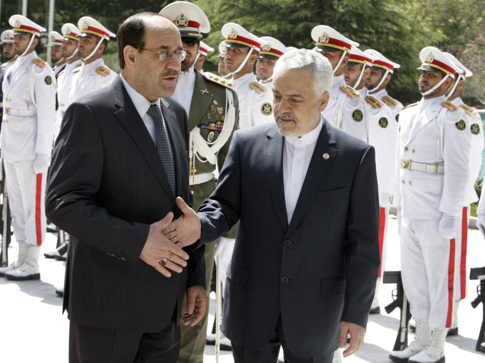 Iraqi Prime Minister Nouri al-Maliki, left, shakes hands with Iranian Vice-President Mohammad Reza Rahimi, during his official arrival ceremony in Tehran, Iran, Sunday, April 22, 2012. (AP Photo/Vahid Salemi)