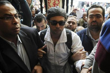 Founder of the April 6 movement Maher turns himself in at Abdeen court in Cairo