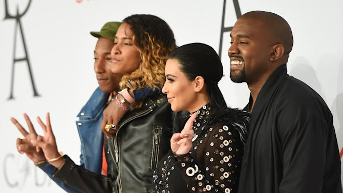 Kanye West and wife Kim Kardashian West pose with Pharrell Williams and wife Helen Lasichanh at the 2015 CFDA Fashion Awards at Alice Tully Hall on Monday, June 1, 2015, in New York. (Photo by Evan Agostini/Invision/AP)