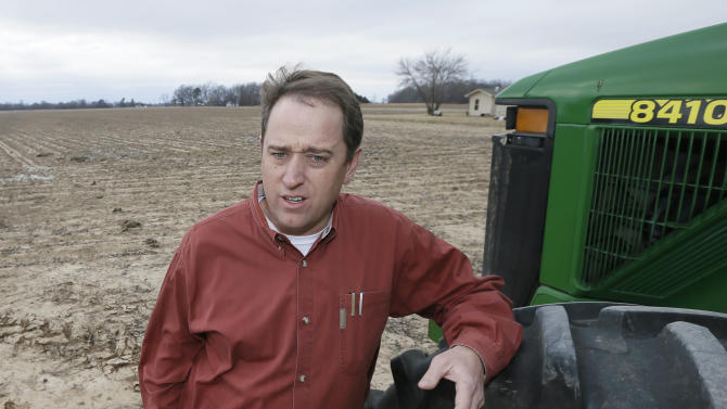 Dow Brantley discusses his plans for the upcoming growing season at one of his fields near England, Ark., Friday, Jan. 31, 2014. Farm subsidies that have guided agriculture through record profits in recent years are going away in the five-year farm bill that could become law as soon as next week. (AP Photo/Danny Johnston)