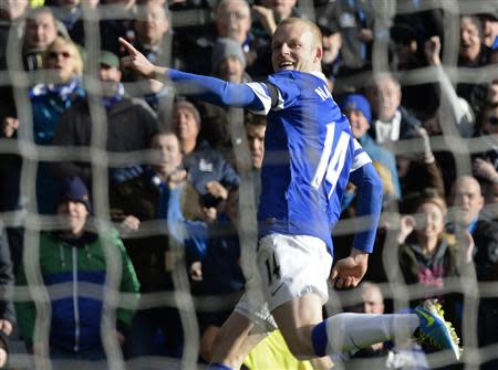 Everton's Naismith celebrates after scoring goal against Swansea during their English FA Cup fifth round soccer match at Goodison park in Liverpool, northern England