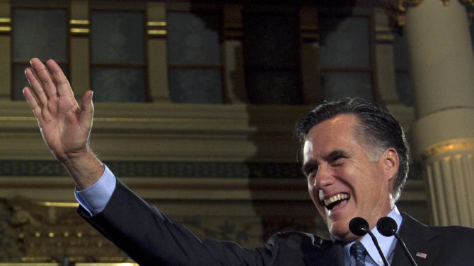 Republican presidential candidate, former Massachusetts Gov. Mitt Romney greets the crowd at a primary election night rally in Milwaukee, Tuesday, April 3, 2012, after Romney won the Wisconsin Republican presidential primary. (AP Photo/Steven Senne)