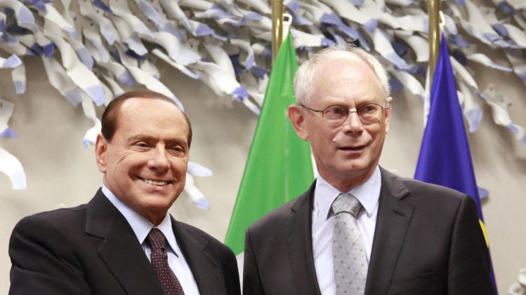 European Council President, Herman Van Rompuy, right, welcomes Italy's Prime Minister, Silvio Berlusconi in his office, prior to a meeting at the European Council building in Brussels, Tuesday, Sept. 13, 2011. (AP Photo/Olivier Hoslet, Pool)