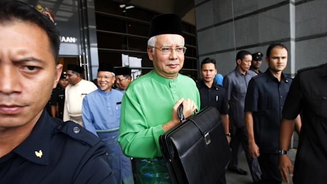 Malaysia unveils spending plans ahead of polls