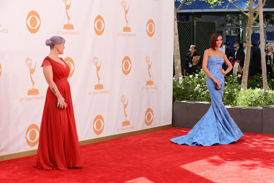 Kelly Osbourne and Giuliana Rancic arrive at the 65th Primetime Emmy Awards at Nokia Theatre on Sunday, Sept. 22, 2013, in Los Angeles. (Photo by Jordan Strauss/Invision/AP)