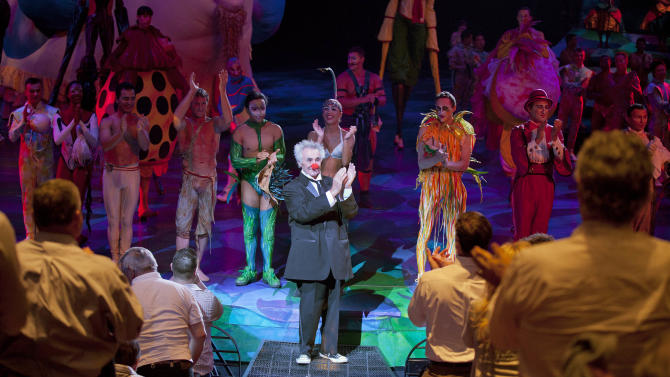 Brian Dewhurst, center, gets a standing ovation after performing as Brian Le Petit in one of two nightly Cirque du Soleil shows of Mystere, Tuesday, May 22, 2012, at Treasure Island hotel-casino in Las Vegas. Performing as a clown over the last 60 years, Dewhurst celebrated his 80th birthday that night and is the oldest performer employed by the upscale circus. (AP Photo/Julie Jacobson)