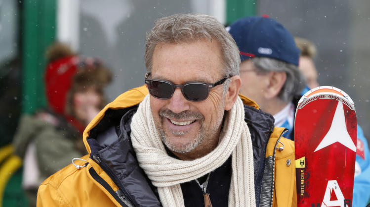 FILE - In this Feb. 9, 2013 file photo, Hollywood actor Kevin Costner watches the men's downhill at the Alpine skiing world championships in Schladming, Austria. Costner is asking $14 million for 1,000 acres of land he owns near the Old West gambling town of Deadwood in western South Dakota's Black Hills. The property includes the site of the ill-fated Dunbar casino resort, a $100 million project that would have included a golf course and a steam-powered passenger train. It never materialized. (AP Photo/Matthias Schrader, File)